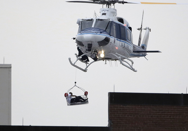A helicopter pulls a possible shooting victim from the Navy Yard. Reuters