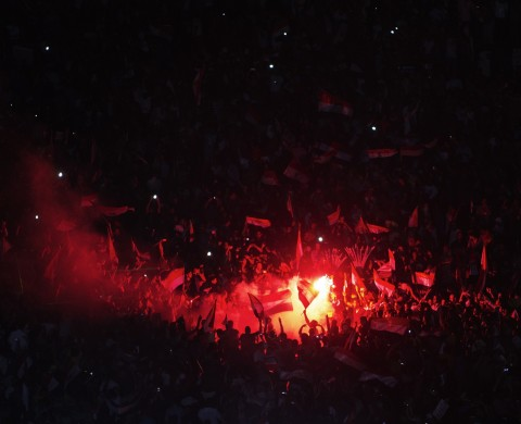 People celebrate at Tahrir Square after a broadcast confirming that the army will temporarily be taking over from the country's first democratically elected president Mohamed Morsi on July 3, 2013 in Cairo. In their tens of thousands, they cheered, ignited firecrackers and honked horns as soon as the army announced Morsi's rule was over, ending Egypt's worst crisis since its 2011 revolt. AFP PHOTO /GIANLUIGI GUERCIA        (Photo credit should read GIANLUIGI GUERCIA/AFP/Getty Images)