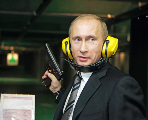 08 Nov 2006, Moscow, Russia --- Russian President Vladimir Putin with a gun, wears protective head gear on a visit to the new headquarters of the Main Intelligence Agency (GRU) of the Russian Armed Forces General Staff. --- Image by © Astakhov Dmitri/ITAR-TASS/Corbis