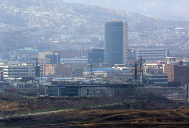Kaesong industrial complex in North Korea is seen from Dora Observation Post near the border village of Panmunjom, that has separated the two Koreas since the Korean War, in Paju, north of Seoul, South Korea, Wednesday, April 10, 2013. Citing the tensions with Seoul, North Korea on Monday pulled more than 50,000 workers from the Kaesong industrial park, which combines South Korean technology and know-how with cheap North Korean labor. It was the first time that production was stopped at the decade-old factory park, the only remaining symbol of economic cooperation between the Koreas.  (AP Photo/Lee Jin-man)