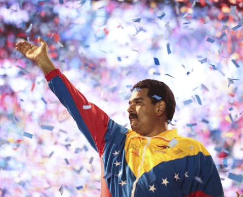 Venezuela's acting President and presidential candidate Nicolas Maduro waves to supporters during a campaign rally at the state of Bolivar, in this picture provided by Miraflores Palace on April 6, 2013. Venezuelans will hold presidential elections on April 14. Picture taken April 6, 2013. REUTERS/Miraflores Palace/Handout (VENEZUELA - Tags: POLITICS ELECTIONS) ATTENTION EDITORS - THIS IMAGE WAS PROVIDED BY A THIRD PARTY. FOR EDITORIAL USE ONLY. NOT FOR SALE FOR MARKETING OR ADVERTISING CAMPAIGNS. THIS PICTURE IS DISTRIBUTED EXACTLY AS RECEIVED BY REUTERS, AS A SERVICE TO CLIENTS