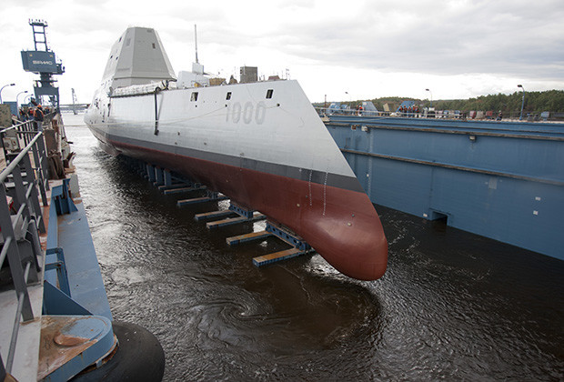 """131028-O-ZZ999-101 BATH, Maine (Oct. 28, 2013) The Zumwalt-class guided-missile destroyer DDG 1000 is floated out of dry dock at the General Dynamics Bath Iron Works shipyard. The ship, the first of three Zumwalt-class destroyers, will provide independent forward presence and deterrence, support special operations forces and operate as part of joint and combined expeditionary forces. The lead ship and class are named in honor of former Chief of Naval Operations Adm. Elmo R. """"Bud"""" Zumwalt Jr., who served as chief of naval operations from 1970-1974. (U.S. Navy photo courtesy of General Dynamics/Released)"""