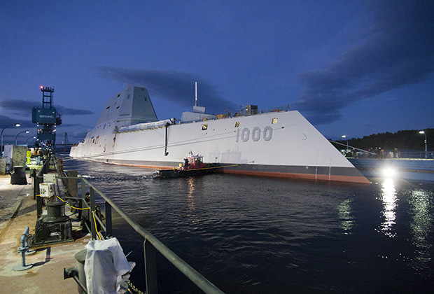 "131028-O-ZZ999-102 BATH, Maine (Oct. 28, 2013) The Zumwalt-class guided-missile destroyer DDG 1000 is floated out of dry dock at the General Dynamics Bath Iron Works shipyard. The ship, the first of three Zumwalt-class destroyers, will provide independent forward presence and deterrence, support special operations forces and operate as part of joint and combined expeditionary forces. The lead ship and class are named in honor of former Chief of Naval Operations Adm. Elmo R. ""Bud"" Zumwalt Jr., who served as chief of naval operations from 1970-1974. (U.S. Navy photo courtesy of General Dynamics/Released)"