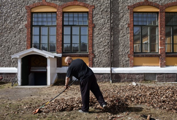 "BASTOY ISLAND, HORTEN, NORWAY - APRIL 11:  Martin, 24 -years-old sentenced to ten months rakes leaves in Bastoy Prison on April 11, 2011 in Bastoy Island, Horten, Norway. Bastoy Prison is a minimum security prison located on Bastoy Island, Norway, about 75 kilometers (46 mi) south of Oslo. The facility is located on a 2.6 square kilometer (1 sq mi) island and hosts 115 inmates. Arne Kvernvik Nilsen, governor of the prison, leads a staff of about 70 prison employees. Of this staff, only five employees remain on the island overnight.  Once a prison colony for young boys, the facility now is trying to become ""the first eco-human prison in the world."" Inmates are housed in wooden cottages and work the prison farm. During their free time, inmates have access to horseback riding, fishing, tennis, and cross-country skiing. (Photo by Marco Di Lauro/Reportage by Getty Images)"