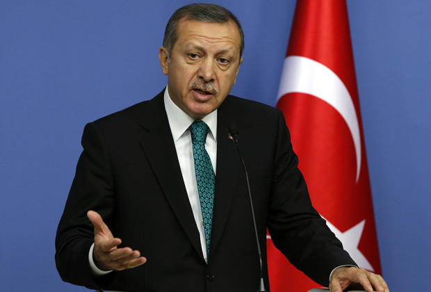 Turkey's Prime Minister Tayyip Erdogan addresses the media in Ankara November 13, 2013. Erdogan said on Wednesday work on the Trans-Anatolian natural gas pipeline project (TANAP), which will carry Azeri natural gas, will begin in early 2014. Turkey, which has a 20 percent stake in TANAP, and Azerbaijan, which controls 80 percent, are looking at ways to cooperate on shipping Azeri gas to the Balkans, Erdogan also said after talks with Azeri President Ilham Aliyev in Ankara. REUTERS/Umit Bektas (TURKEY - Tags: POLITICS BUSINESS)