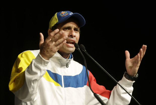 Henrique Capriles, governor of the state of Miranda and opposition leader in Venezuela, gestures as he speaks to supporters, Sunday, Sept. 15, 2013 in Miami. Capriles narrowly lost the April 14 presidential election to late President Hugo Chavez's hand-picked successor, Nicolas Maduro. Capriles and his supporters claim Maduro stole the election through fraud. (AP Photo/Wilfredo Lee)