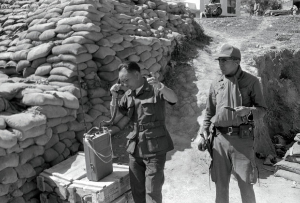 21 Jan 1972, Laos --- Original caption: General Vang Pao, the Commander of Laotian forces at the once-secret base here, calls in air strikes against suspected Communist positions from the Long Cheng Command Post here on January 19th. Central Intelligence Agency (CIA) agents had become accustomed to operating unfettered by the scrutiny of the American public, but on January 21st, newsmen were admitted and given free access to the base for the first time in its 10-year history. --- Image by © Bettmann/CORBIS