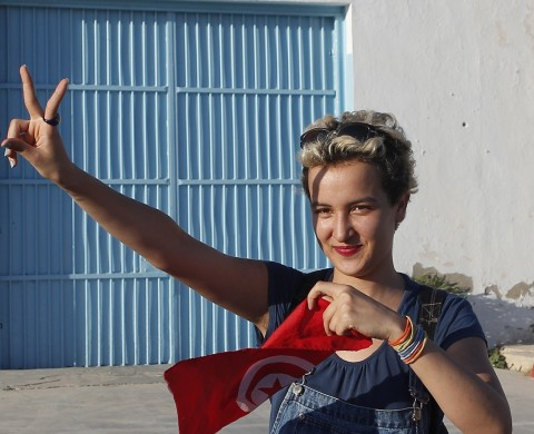 Amina Sboui, the Tunisian member of the Ukrainian feminist group Femen, gestures after she is released from prison in Sousse August 1, 2013. Amina was arrested in Kairouan on May 19 for placing a feminist banner on the wall of a mosque and trying to expose her breasts. REUTERS/Med Amine Benaziza (TUNISIA - Tags: POLITICS CIVIL UNREST CRIME LAW RELIGION TPX IMAGES OF THE DAY)