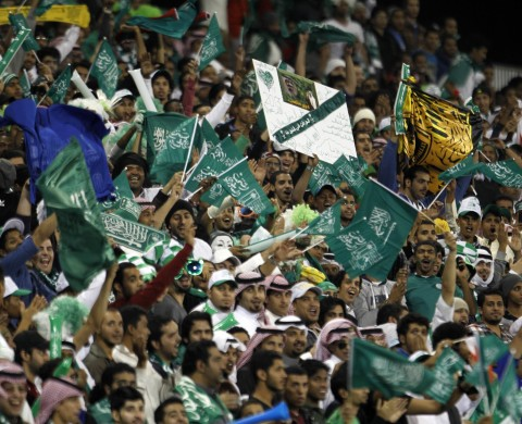 06 Jan 2013, Madinat 'Isa, Bahrain --- Saudi Arabia's fans on their team during their Gulf Cup tournament soccer match against Iraq in Isa Town, January 6, 2013. REUTERS/Hamad I Mohammed (BAHRAIN - Tags: SPORT SOCCER) --- Image by © HAMAD I MOHAMMED/Reuters/Corbis
