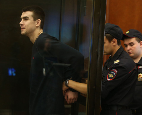 Denis Lutskevich (L) appears in Zamoskvoretsky District Court for a hearing into the case over mass riots in Moscow's Bolotnaya Square during the opposition rally on May 6, 2012.