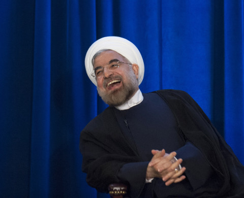 Iran's President Hassan Rouhani laughs as he speaks during an event hosted by the Council on Foreign Relations and the Asia Society in New York, September 26, 2013.  REUTERS/Keith Bedford (UNITED STATES - Tags: POLITICS) - RTX14196