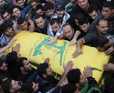 Lebanon's Hezbollah members carry the coffin of their comrade Wissam Sharafeddine, who was killed in the recent eastern Ghouta battles in Damascus, Syria, during his funeral in Recheknanay village, southern Lebanon, November 30, 2013. The Syrian Observatory for Human Rights, a British-based monitoring group, said more than 400 people had been killed across Syria since Thursday, many of them in the battles around Ghouta and Qalamoun. Casualties on both sides have been heavy, with Hezbollah losing at least 25 fighters in eastern Ghouta over the last week, according to security sources in Lebanon. REUTERS/Haidar Hawila (LEBANON - Tags: CIVIL UNREST MILITARY POLITICS CONFLICT) - RTX15YV5