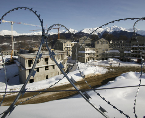 Barbed wires secure the mountain cluster of the Olympic village undergoing construction at the Rosa Khutor Alpine Resort in the western Caucasian mountains near Krasnaya Polyana, some 40 km (25 miles) outside of the Black Sea city of Sochi February 13, 2012. Rosa Khutor is hosting the Alpine and snowboard events at the 2014 Sochi Winter Olympic Games.     REUTERS/Wolfgang Rattay  (RUSSIA - Tags: SPORT SKIING BUSINESS CONSTRUCTION OLYMPICS) - RTR2XS5N