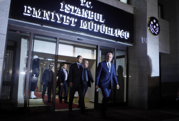 """Istanbul police chief Huseyin Capkin (Front) leaves the police headquarters in Istanbul December 18, 2013. Turkish Deputy Prime Minister Bulent Arinc said on Wednesday a corruption investigation in which 52 people including the sons of three cabinet ministers have been detained was part of a """"planned operation"""" to tarnish the government. In the first official comments on the investigation from a senior member of the government, Arinc also said politics would not be allowed to stand in the way of the inquiry. REUTERS/Osman Orsal (TURKEY - Tags: CRIME LAW POLITICS) - RTX16NJB"""