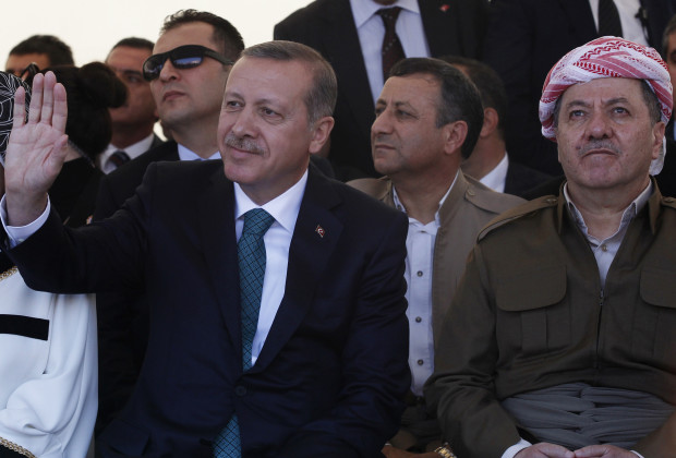Turkey's Prime Minister Tayyip Erdogan and President of Iraqi Kurdistan Masoud Barzani (R) attend a ceremony with Erdogan's wife Emine Erdogan in Diyarbakir November 16, 2013. The president of Iraqi Kurdistan called on Turkey's Kurds to back a flagging peace process with Ankara on Saturday, making his first visit to southeastern Turkey in two decades in a show of support for Prime Minister Tayyip Erdogan. Barzani's trip to Diyarbakir, the main city in Turkey's Kurdish-dominated southeast, comes as Ankara finalises billions of dollars of energy deals with his semi-autonomous region and amid mutual concern over the ambitions of Kurdish militias in the chaos of neighbouring Syria.     REUTERS/Stringer (TURKEY  - Tags: POLITICS)   - RTX15G48