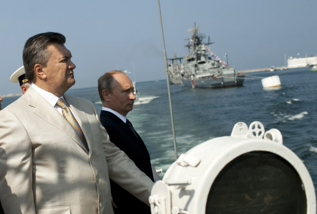 Russian President Vladimir Putin (R) and his Ukrainian counterpart Viktor Yanukovych attend a ceremony celebrating Navy Day in Sevastopol on July 28, 2013.   AFP PHOTO/ PRESIDENTIAL PRESS-SERVICE POOL/ MYKHAYLO MARKIV        (Photo credit should read MYKHAYLO MARKIV/AFP/Getty Images)