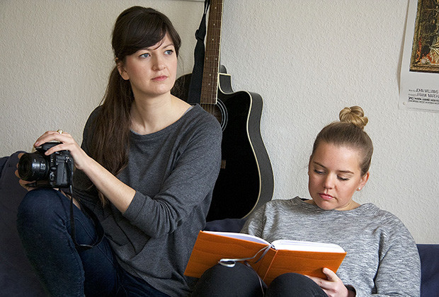 Jule Müller, left, and Anni Kralisch-Pehlke, right, interview a single for their three-month old website, im gegenteil on a recent morning.