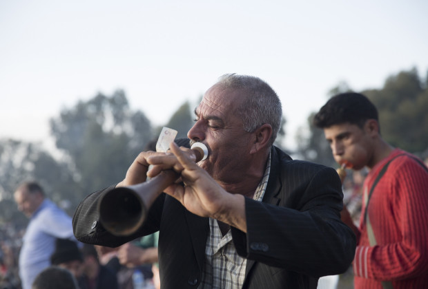 A Gypsy musician plays the zorna, a horn instrument during the Camel Wrestling Festival in Selcuk Efes. Teams of Gypsy musicians roam the fairgrounds playing traditional music which incites people to dance, or in some cases, to pay them to go away. Photo by Jodi Hilton/Vocativ