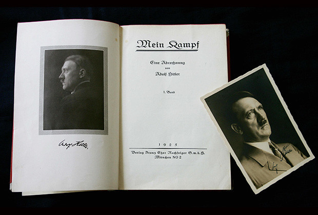 London, UNITED KINGDOM:  A signed copy of a first edition of Adolf Hitler's book Mein Kampf goes on display at Bloomsbury Auction House, London, 14 June 2005. The book is part of a lot, which also features a signed photograph of the Nazi leader and pictures of his meeting with British Prime Minister Neville Chamberlin in September 1938 and sheets of embossed Nazi stationary paper. The lot is expected to fetch up to GBP25,000. (37,000 Euros)    AFP PHOTO/CARL DE SOUZA  (Photo credit should read CARL DE SOUZA/AFP/Getty Images)