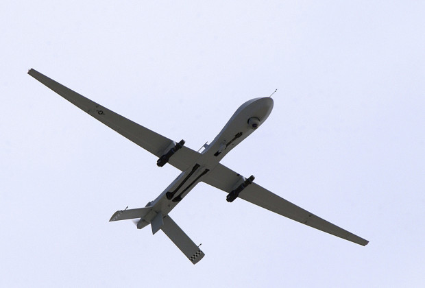 A U.S. Air Force MQ-1 Predator, unmanned aerial vehicle, armed with AGM-114 Hellfire missiles, performs a low altitude pass during the Aviation Nation 2005 air show at Nellis Air Force Base, Nevada in this November 13, 2005 USAF handout photo obtained by Reuters February 6, 2013. REUTERS/U.S. Air Force/Airman 1st Class Jeffrey Hall/Handout  (UNITED STATES - Tags: MILITARY POLITICS) THIS IMAGE HAS BEEN SUPPLIED BY A THIRD PARTY. IT IS DISTRIBUTED, EXACTLY AS RECEIVED BY REUTERS, AS A SERVICE TO CLIENTS. FOR EDITORIAL USE ONLY. NOT FOR SALE FOR MARKETING OR ADVERTISING CAMPAIGNS - RTR3DF76