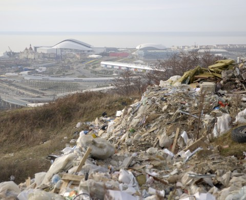 A picture taken on December 27, 2013, shows a general view of the Olympic Park in the Russian Black Sea resort of Sochi with a dump in the background. The Olympic Park will be able to accommodate about 75000 visitors when full, and all the ice arenas will be within walking distance of one other. Sochi will host the 2014 Winter Olympics that start on February 7, 2014. But there is now little trace of any wildlife as the area has been built up in record time to become the Olympic Park, which houses the stadium that will host the opening ceremony for Russia's Winter Olympics. AFP PHOTO / MIKHAIL MORDASOV        (Photo credit should read MIKHAIL MORDASOV/AFP/Getty Images)