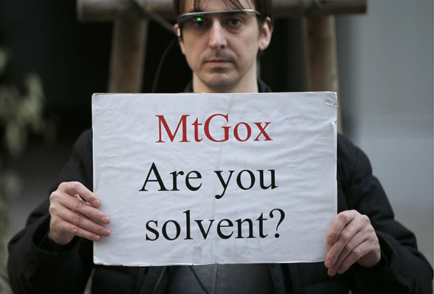 Protester Aaron holds a placard during a demonstration against Mt. Gox, in front of the building where the digital marketplace operator is housed, in Tokyo February 25, 2014. The website of Mt. Gox appears to be taken down, shortly after six major Bitcoin exchanges released a joint statement distancing themselves from the troubled Tokyo-based bitcoin exchange. Tokyo-based Mt. Gox was a founding member and one of the three elected industry representatives on the board of the Bitcoin Foundation.