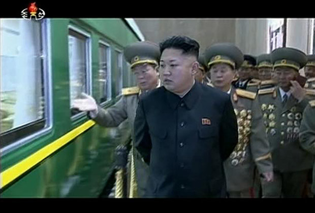 North Korean leader Kim Jong Un (2nd L) and officials look at a train used by late North Korean leader Kim Jong Il during a visit to the Kumsusan Palace of the Sun to commemorate the 22nd anniversary of Kim Jong Il's assumption of the supreme commandership of the Korean People's Army (KPA) in this still image taken from video released by KRT, North Korean state TV on December 24, 2013.