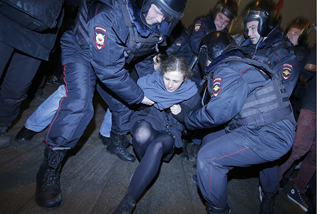 Punk protest band Pussy Riot member Maria Alyokhina is detained by police at a protest in central Moscow February 24, 2014. Russian riot police detained over a hundred protesters, including two members of Pussy Riot, on Monday at a Moscow courthouse where seven opponents of President Vladimir Putin were jailed from two and a half to four years over a demonstration that turned violent.