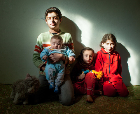 Gaziantep, Turkey 2014 Omar (13) with his Turkish born brother Mohammed and two sisters sit for a portrait.
