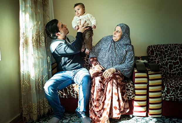 Gaziantep, Turkey 2014 Yusuf al-Abdullah sits for a portrait with his Turkey born baby Ahmed, and Amneds grandmother.