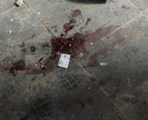 Picture taken on June 25, 2013 showing blood left in a house in a slum complex in Rio de Janeiro after gunbattles erupted late Monday. Seven people, including one police officer, were fatally shot during confrontations in a favela near Rio's international airport, authorities said on Tuesday. Brazil is currently facing unprecedented social unrest, marked by almost daily street protests to demand better public services and an end to rampant political corruption as the FIFA Confederations Cup Brazil 2013 football tournament is being held in the country.    AFP PHOTO / YURI CORTEZ        (Photo credit should read YURI CORTEZ/AFP/Getty Images)