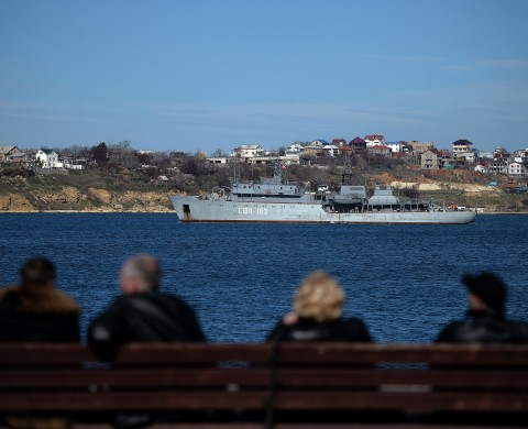 A Russian Navy De-Gaussing Ship passes in Sevastopol harbour on March 3, 2014. The Russian Black Sea Fleet commander Aleksandr Vitko has issued an ultimatum to the Ukrainian military personnel in Crimea, the Interfax-Ukraine news agency reported. Ukraine accused Russia on Monday of pouring more troops into Crimea as world leaders grappled with Europe's worst standoff since the Cold War and the Moscow market plunged on fears of an all-out conflic  AFP PHOTO/Filippo MONTEFORTE        (Photo credit should read FILIPPO MONTEFORTE/AFP/Getty Images)