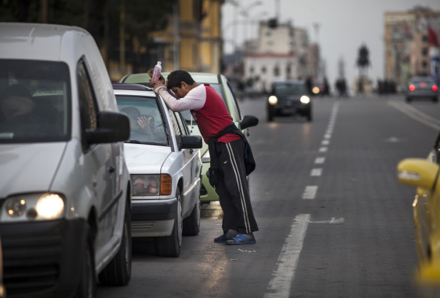 A Roma boy washes car windshields to collect money for his family in downtown Tirana, the capital of Albania. Most of the several thousand Roma living there subsist by some form of begging or collecting recyclable trash.  PHOTO BY JODI HILTON