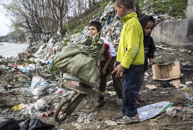 Children collect recyclable materials on the banks of the Tirana River at Babru, a small Roma settlement. Residents go through trash in order to collect plastic and metal materials. PHOTO BY JODI HILTON
