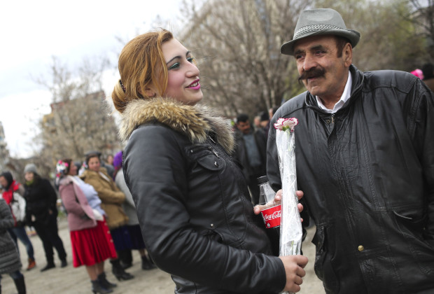 """Nina Petkova, 19, a girl of marriageable age with her father, Kolio Petrov at the annual meeting of the  Kalaidzhi Roma clan. The so-called """"Gypsy Bride Market"""" is an opportunity for young men and women have a chance to meet and flirt under the watchful eyes of their parents and for marriages to be arranged."""