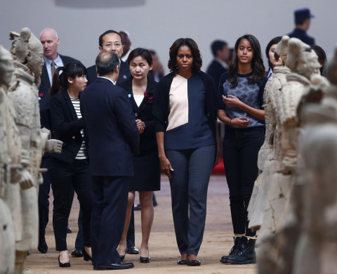 U.S. first lady Michelle Obama (C) and her daughter Malia (R) walk as they visit the Museum of Qin Terracotta Warriors and Horses, in Xi'an, Shaanxi province, March 24, 2014. REUTERS/Petar Kujundzic (CHINA - Tags: POLITICS TRAVEL) - RTR3IALW
