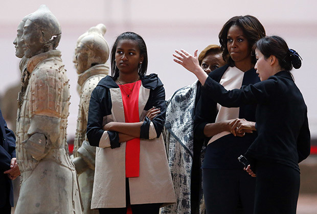 U.S. first lady Michelle Obama (2nd R), her daughter Sasha (L) and her mother Marian Robinson listen to a guide as they visit the Museum of Qin Terracotta Warriors and Horses, in Xi'an, Shaanxi province, March 24, 2014.
