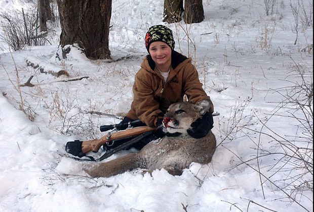 Shelby's younger brother, 9-year-old Cody, poses with a cougar he slayed earlier in February. It was his first cougar kill.