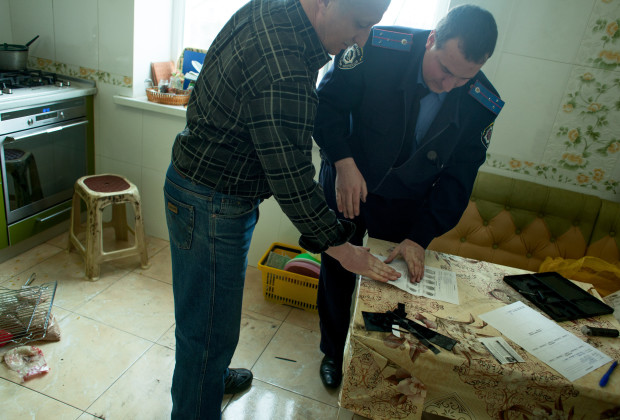 Bakhchysaray, Crimea 2014 Police investigating the break in a Crimean Tatar house.