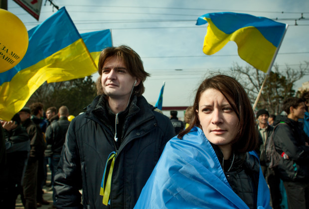 Simferopol, Crimea 2014 A protester and passers by at a pro-Ukrainian rally commemorating the 200th birth day of Taras Shevchenko, Ukraine's national poet.