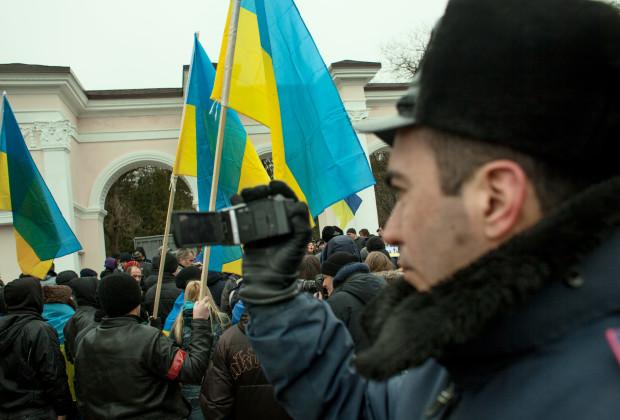 Simferopol, Crimea 2014 Crimean police filming protesters in a pro-Ukrainian rally.