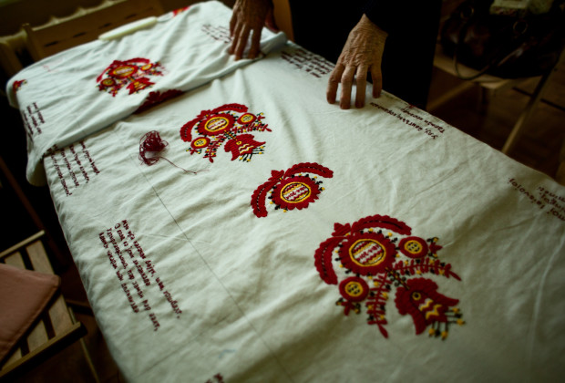 Simferopol, Crimea 2014 Old ladies showing the embroidery commemorating the 200th birth day of Taras Shevchenko in a museum.