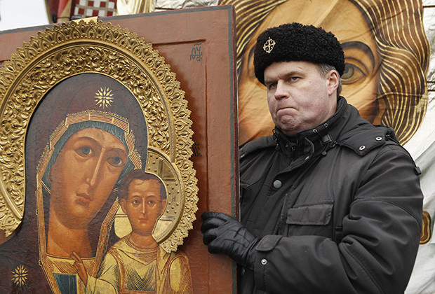 "A Russian nationalist holds an icon as he attends a ""Russian March"" demonstration on National Unity Day in Moscow"