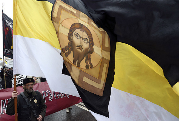 Orthodox believer attends a Russian March rally on National Unity Day in Moscow.
