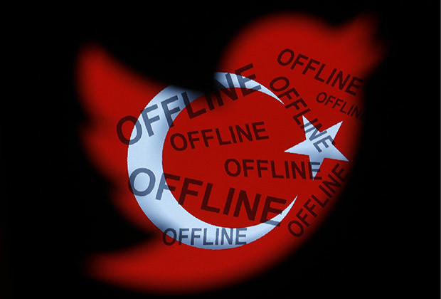 """A Turkish national flag with the word 'offline' projected on it, is seen through a Twitter logo in this photo illustration taken in Zenica, March 21, 2014. Turkey's courts have blocked access to Twitter a little over a week before elections as Prime Minister Tayyip Erdogan battles a corruption scandal that has seen social media awash with alleged evidence of government wrongdoing. The ban came hours after a defiant Erdogan, on the campaign trail ahead of key March 30 local elections, vowed to """"wipe out"""" Twitter and said he did not care what the international community had to say about it."""