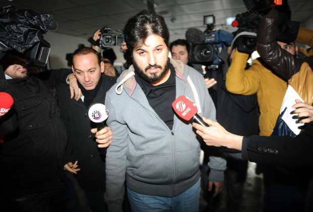 Detained Azerbaijani businessman Reza Zarrab (C) is surrounded by journalists as he arrives at a police center in Istanbul on December 17 ,2013. Turkish police detained more than 20 people including the sons of three cabinet ministers and several high-profile businessmen on December 17 in a probe into alleged bribery and corruption, local media reported. Prime Minister Recep Tayyip Erdogan's ruling Justice and Development Party (AKP), which boasts of being pro-business, has pledged to root out corruption, a chronic problem in Turkey.  AFP PHOTO / OZAN KOSE        (Photo credit should read OZAN KOSE/AFP/Getty Images)