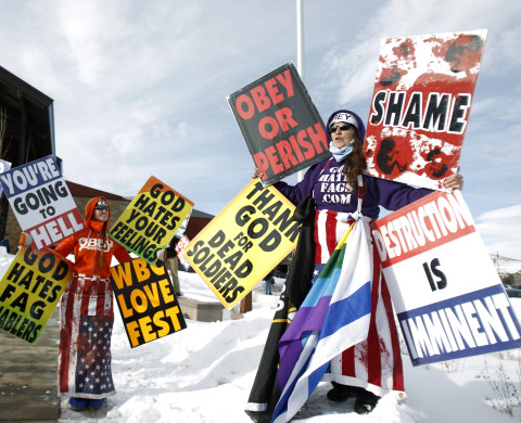"Members from the Westboro Baptist Church protest the upcoming premiere of ""Red State"" during the Sundance Film Festival in Park City, Utah January 23, 2011.  REUTERS/Mario Anzuoni (UNITED STATES - Tags: ENTERTAINMENT CIVIL UNREST RELIGION) - RTXWZGG"