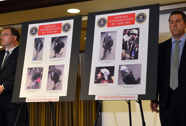 FBI agents stand next to photographs of two suspects wanted in the Boston Marathon bombings released by the FBI at a press conference on April 18, 2013 in Boston, Massachusetts. The suspects were later identified by authorities as brothers Tamerlan (L) and Dzhokar Tsarnaev (R).  AFP PHOTO/Stan HONDA        (Photo credit should read STAN HONDA/AFP/Getty Images)