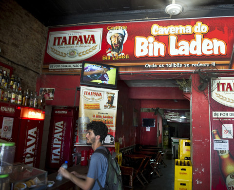 A customer buys a bottle of mineral water at the Bin Laden's cave bar in Niteroi, 25 kms northern of Rio de Janeiro, Brazil on May 05, 2011. The bar, on sale since one week ago, is located in a universitary neighborhood and took the name of the Al-Qaeda chief Osama bin Laden as a joke to create a different mark among the others in the area.    AFP PHOTO / ANTONIO SCORZA (Photo credit should read ANTONIO SCORZA/AFP/Getty Images)