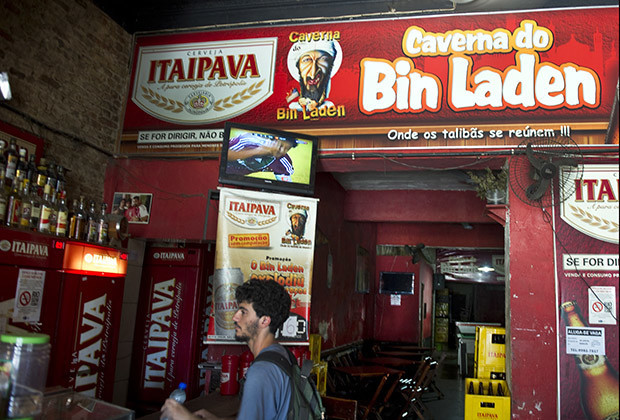 A customer buys a bottle of mineral water at the Bin Laden's cave bar in Niteroi, 25 kms northern of Rio de Janeiro, Brazil.